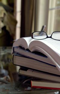 glasses resting on a stack of books