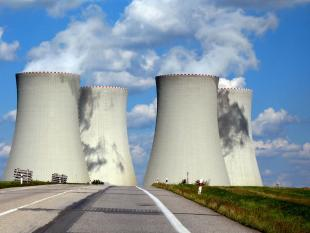 cooling towers under a blue sky