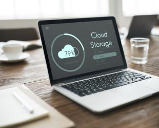 "Laptop with screen reading ""Cloud Storage"" on it"