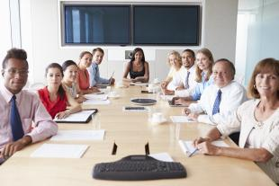 Group of diverse business people in boardroom for a meeting