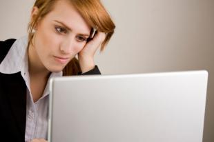 frustrated woman looking at computer