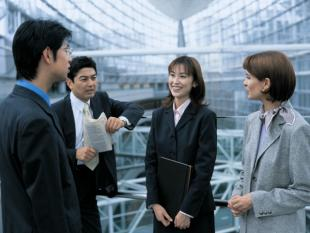 Business woman interviewing with a team of businessmen and women
