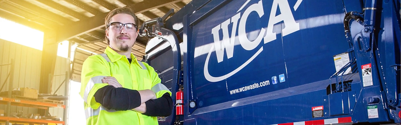 WCA Waste Corporation, Man standing in front of WCA truck, Opensesame